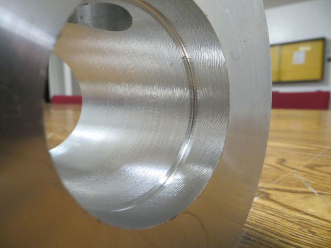 O-ring groove to seal with  chamber wall