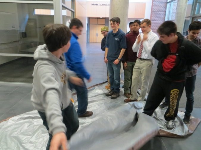 LPRD Rocketry members successfully flip a tarp team building challenge