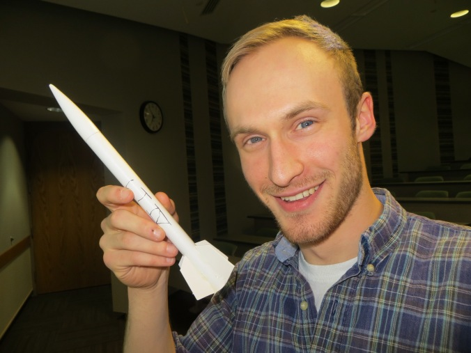 Lee of LPRD Rocketry holding up his constructed model rocket