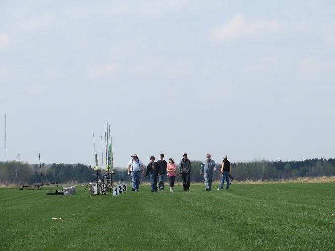 LPRD rocketry members walking back after loading rocket onto launch rail